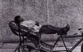 Resting Rickshaw Wallah
